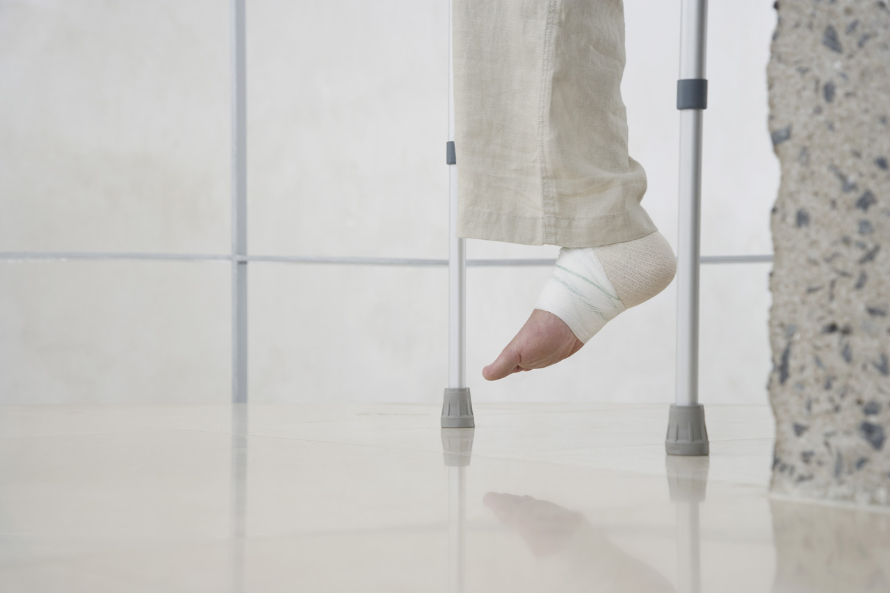 Human-foot-of-person-on-crutches-low-section